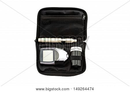 blood glucose meter, the blood sugar value is measured on a finger pack in black case on white background.Saved with clipping path.