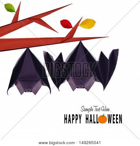 Origami paper halloween hanging bats couple on a branch on white background