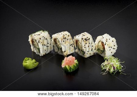 Uramaki maki sushi. Philadelphia cheese avocado and sesame