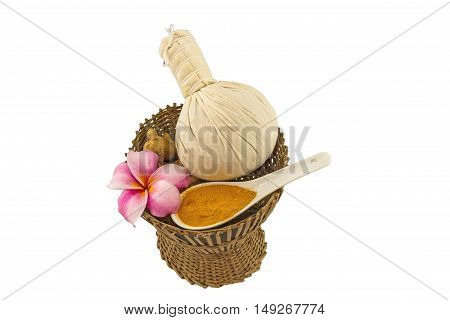 Spa herbal compressing ball white frangipani flowers (Plumeria spp Apocynaceae Pagoda tree Temple tree) turmeric powder in white spoon and candle on bamboo basket isolate on white background