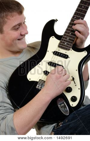 The young man is keen playing on an electroguitar poster