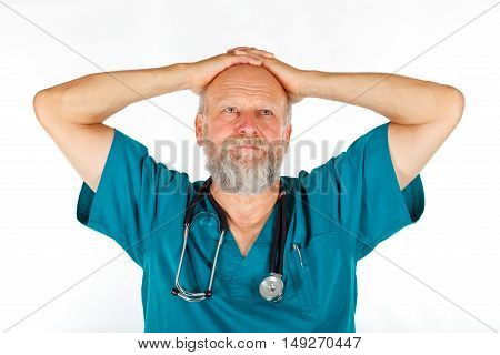 Picture of a male surgeon being worried about his patient