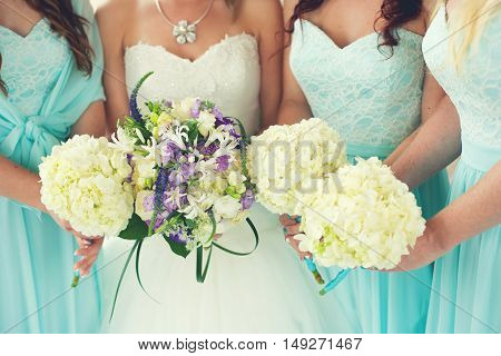 Close up of bride and bridesmaids bouquets (bridesmaid)