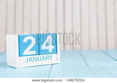 January 24th. Day 24 of month, calendar on wooden background. Winter concept. Empty space for text.