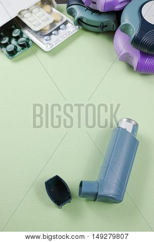 Asthma allergy illness relief concept salbutamol inhalers aerosol medication drugs copy space