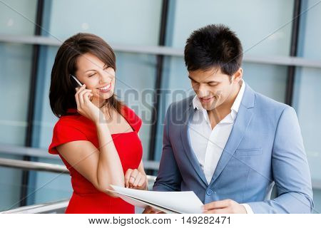 Two young business collegue in office