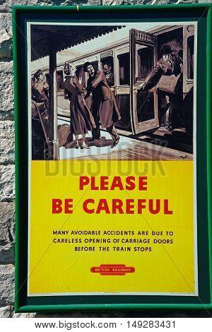 CORFE, UNITED KINGDOM - JULY 19, 2016 - Old fashioned British Railways Be Careful poster at the railway station Corfe Dorset England UK Western Europe, July 19, 2016.