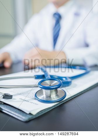 Medicine doctor's working table. Focus on stethoscope. Doctor man. Doctor woman. Tool doctor. Uniform doctor. Doctor sitting. Doctor working. Doctor room,