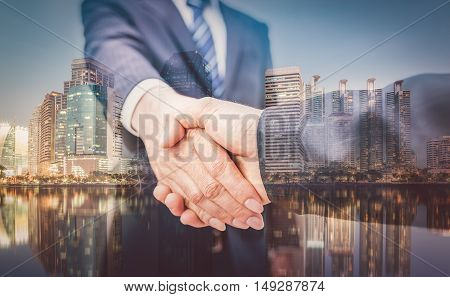 Business Man. Business handshake and business people on city background vintage tone. Business Man. Business handshake and business people vintage tone. Business shake hand. Business working. Business room. Business office.