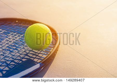 Tennis Ball and Racket on sunset . Tennis Ball and Racket in tennis cort, Tennis court, Tennis ball, Tennis racket, shadow tennis, Tennis sport, Tennis concept, Tennis ball green color, Tennis racket blue color