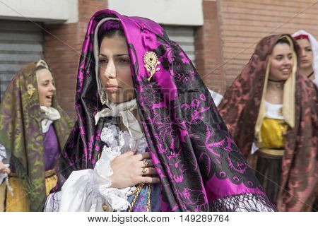 CAGLIARI, ITALY - May 1, 2013: 357 ^ Religious Procession of Sant'Efisio - Sardinia - portrait of a beautiful woman in traditional Sardinian costume