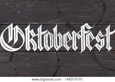 Lettering Oktoberfest for Oktoberfest Beer Festival. Hand drawn lettering of fraktur font for bar menu, t-shirt print and beer themes. Oktoberfest celebration design. Vector Illustration