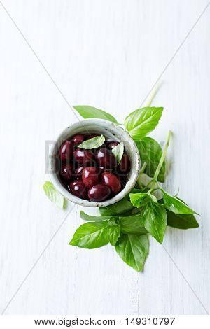 Fresh basil leaves and kalamata olives