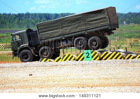 MOSCOW REGION  -   JUNE 18: Military all terrain truck  on a march over rough terrain with barriers -  on June 18, 2015 in Moscow region