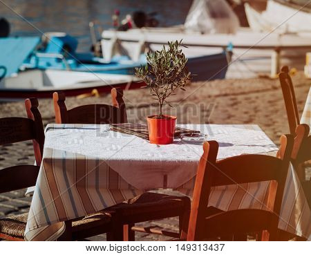 Greek tavern concept- cafe table near the sea in Greece