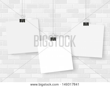 Posters template on grey brick wall. Realistic wall gallery vector illustration. Set of colorful empty vector notes mockup for your illustrations drawings posters or quotes.