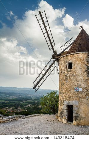 Old stone windmill in Saint Saturnin les Apt, Provence, France
