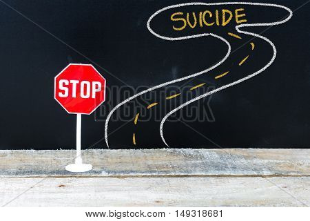 Mini Stop Sign On The Road To Suicide