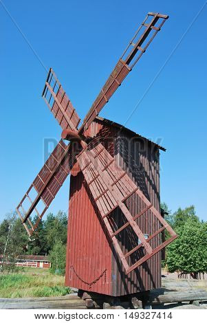 Restored wooden windmill in ancient city park