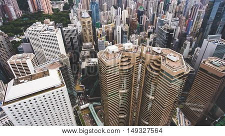 Top view aerial photo from flying drone of a business center in China with headquarter and office buildings with contemporary architecture. Exterior of a skyscrapers in metropolitan Hong Kong city
