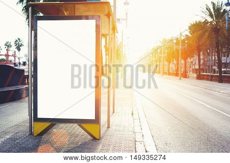 Blank billboard with copy space area for your text message or promotional content public information board on the street advertising mock up empty banner in metropolitan city at beautiful evening