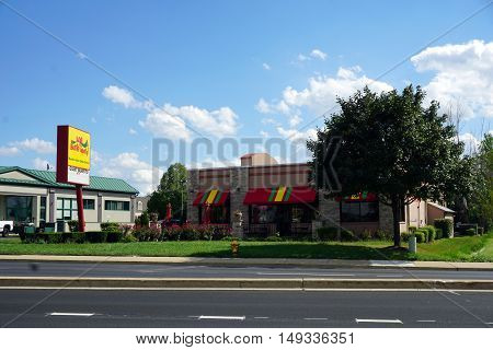 BOLINGBROOK, ILLINOIS / UNITED STATES - SEPTEMBER 17, 2016: One may eat a giant burrito at Los Burritos Tapatios in Bolingbrook.