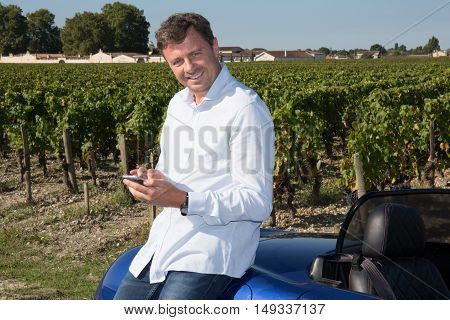 Businessman, Winegrower, With Cell Phone The Grape Fields