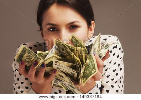 Happy young successful Business Woman sniffing the smell of money (Wealth abundance  happiness)