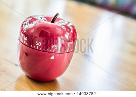 55 Minutes - Kitchen Egg Timer In Apple Shape On Wooden Table