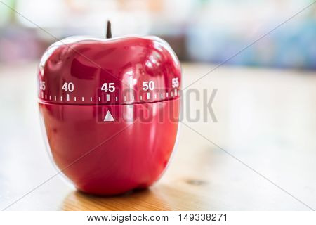 45 Minutes - Kitchen Egg Timer In Apple Shape On Wooden Table