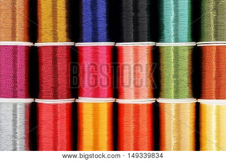 colorful spools of thread as a background