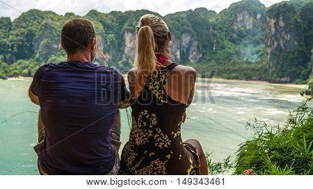 A Couple on View Point t Hat Tom Sai Beach at Railay near Ao Nang, Krabi, Thailand.