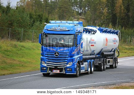 PAIMIO FINLAND - SEPTEMBER 23 2016: Mercedes-Benz Actros 2651 tank truck for bulk transport of Eja-Trans Oy moves along road in South of Finland in autumn.
