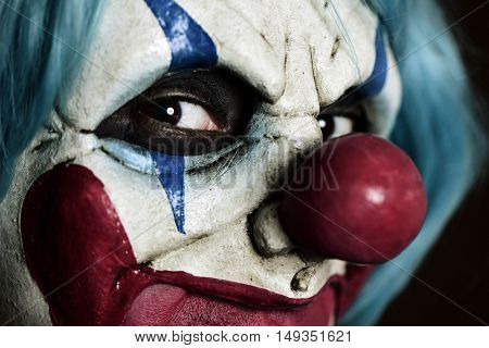 closeup of a scary evil clown