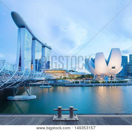Singapore, Republic of Singapore - May 3, 2016: Panorama of Marina Bay with Marina Bay Sands hotel and Artscience lotus flower museum glowing at night