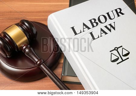 Labour law book and gavel. Consumer protection book and gavel. Law and regulations concept. poster