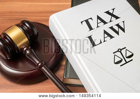 Tax Law Book And Gavel. Consumer Protection Book And Gavel. Law