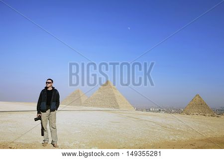 photographer on the background of the desert and the pyramids of Egypt Egypt