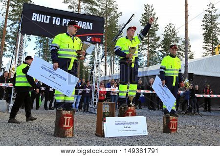 JAMSA FINLAND - SEPTEMBER 2 2016: Winner Jari Sarajarvi left 2nd placed Jari Asikainen and right 3rd placed Tommi Matikainen on the prize ceremony of the Finnish Championships in Log Loading 2016 held at FinnMETKO 2016.