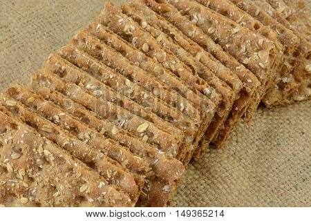 Multi grain whole grain crispbread crackers on burlap