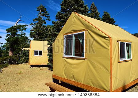 Modern rustic tent cabins which provide people with a comfortable camping experience taken at a forest in Mt Baldy, CA