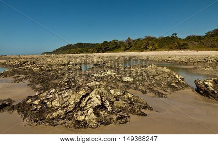 Rock pools at low tide in costa Rica poster