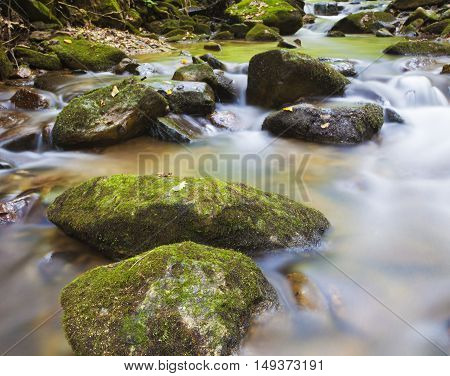 Water going over some rocks in the early morning on Pisgah National Forest