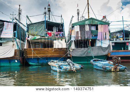 HAINAN CHINA - 12.09.2016: fishing village of poor people on the sea water in island Hainan China