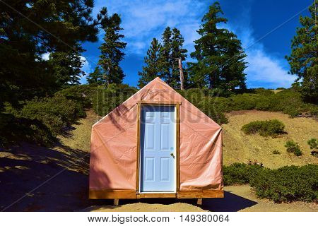 Tent cabin for a comfortable camping experience surrounded by a Pine Forest taken in Mt Baldy, CA