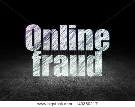 Security concept: Glowing text Online Fraud in grunge dark room with Dirty Floor, black background