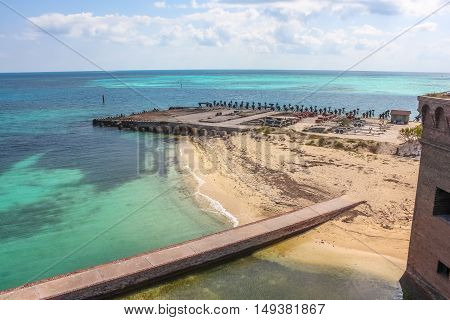 North Coaling Dock Ruins of Fort Jefferson in Dry Tortugas National Park situated at the southwest corner of the Florida Keys reef system ed is one of the United States' most remote national parks.