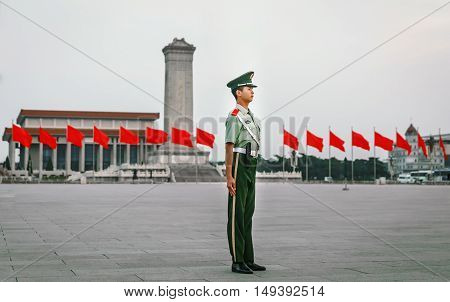 BEIJING - CHINA, MAY 2016: Honor guard soldiers at Tiananmen on May 19, 2016. Honor guards are provided by the People's Liberation Army at Tiananmen Square. Chinese flags on the background