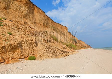 hill on the coastline is destroyed by landslide
