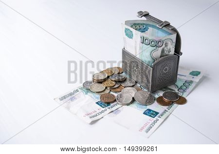 Iron chest with coins and small denomination